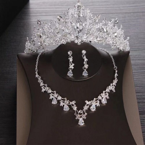 Necklaces, Earrings, And Tiaras Worn By The Bride And Princess